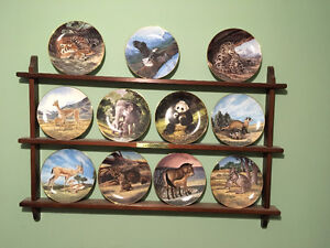 11 Collector Plates with Wall Rack. Endangered Species Series