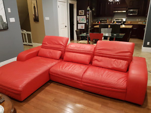 Red leather couch and chaise.