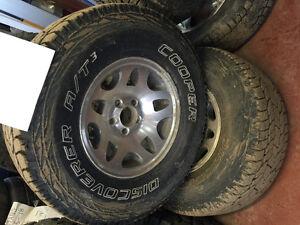 31x10.5 R15 tires on wheels. 5x4.5 inch bolt pattern