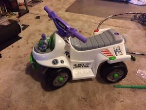 Buzz light year power wheels quad.