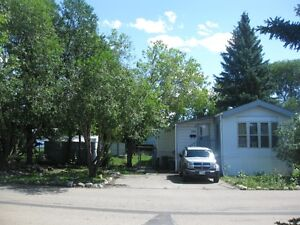 Mobile home in Evergreen with recent upgrades and large yard