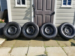 4 Dunlop Winter Maxx Tires on Steel Wheels 215/55/R16