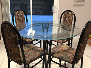 Glass round dining table with four chairs