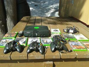 xbox 4 manettes et une télécomende et jeux a échanger