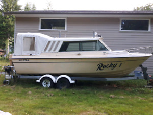 "24""ft Sufer Fishing boat and trailer plus 20 hp kicker"