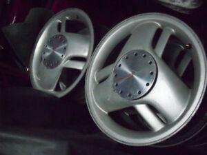 "4xmags 16"" pontiac sunfire 5x100 , $125."