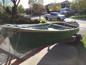 15.8 ft Scanoe with 2 life jackets and 2 paddles (no trailer)