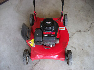 Lawnmower for sale. Just tuned up. Runs perfect!