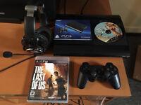 PS3 Ultra Slim 250gb, headset, 1 manette sans fil et 2 jeux