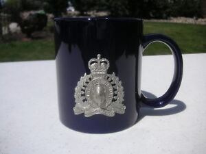 OLDER RCMP COFFEE MUGS