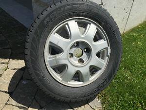 4 mags rims wheels et pneu 185/65/14 pour chevrolet aveo5 2005.