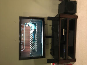 "46"" Samsung LED TV with TV stand and Surround Sound inl sub"