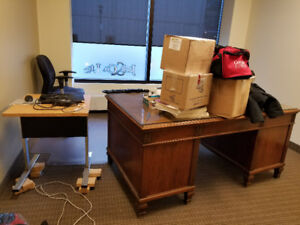 Antique wood desks, metal filing cabinets and various chairs