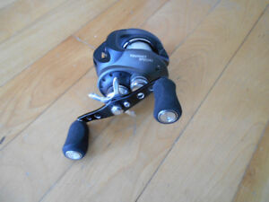 Moulinet baitcaster peche,comme neuf, spin gauche, fish reel