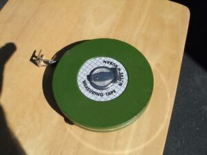 100 ft tape and meter tape together