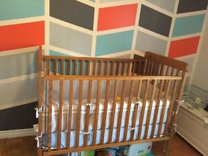 Baby crib with change table and bumber