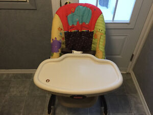 Fisher-Price padded high chair.