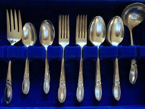 8 Place Setting of White Orchid by Community (Oneida)