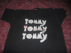 The WHO's Tommy T shirt, hard cover book, and poster