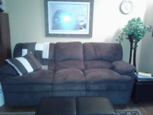 brown microfibre couch with two built in recliners