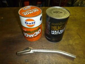 VINTAGE CANS OF MOTOR OIL AND FILLER