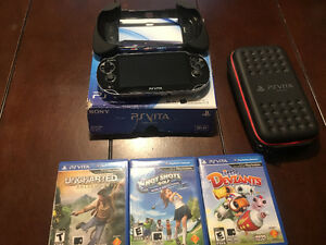 PS Vita with 16 GB memory card and accessories