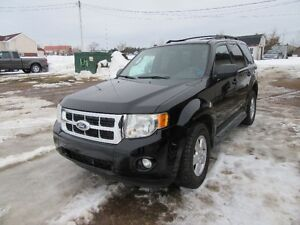 2009 Ford Escape XLT SUV, AWD only  63 000 km on motor 3.0 L V6
