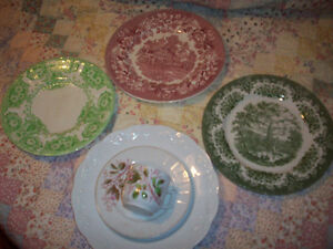 4 larger plates, one smaller with matching cup