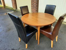 Round dining table with four comfy chairs contactless collection