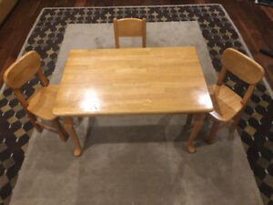 CHILDREN'S SOLID WOOD TABLE AND CHAIRS