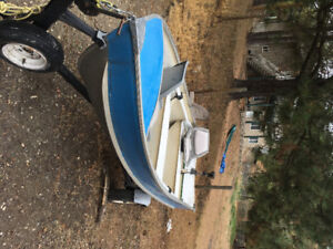 12' Aluminum boat with swivel seats and electric motor $800