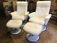Cream swivel recliner chairs pair