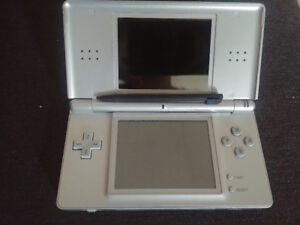 Nintendo DS Lite with charger and game cases/games