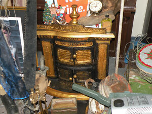 firm, ANTIQUE  Newfoundland Foundry wood stoves