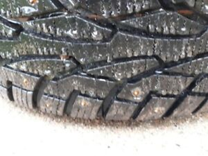 Four studded 195/65R15 winter tires on rims