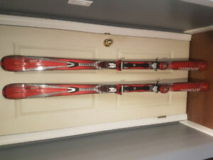 172 cm Atomic Drive 9 Titan skis with bindings, boots, and poles