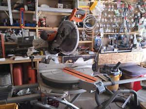 """As new, used twice RIDGID 12"""" Compound mitre saw and stand."""