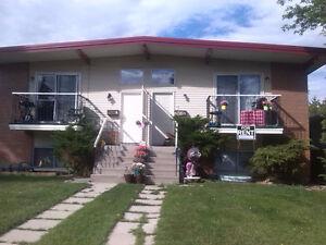 Bright beautiful upper 4-plex unit for rent in Bowness