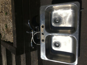 Stainless steel kitchen sink with Delta faucet