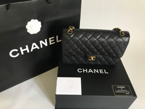 Chanel classic flap black caviar leather and gold hardware