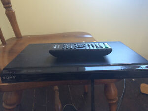 Sony DVD player with remote plus 26 movies