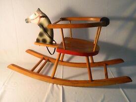 Childs rocking chair with horse head.