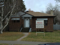 large home on corner lot in McDougall