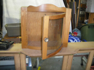 SMALL WOODEN BOW GLASS CABINET