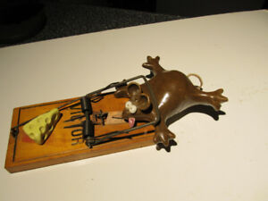 Mouse caught in a trap, vintage home decor.