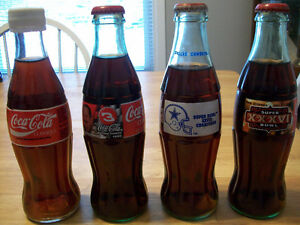 Lot of 8oz assorted coke cola collectable bottles