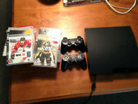 PS3 with games and two controllers for sale