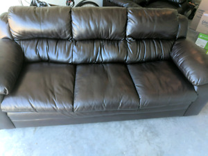 Dark brown leather couch and love seat in almost new condition