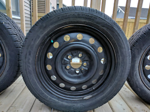 4 good year triple tred all season tires very well need to sell