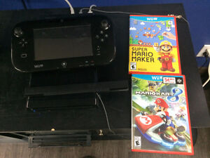 wii u console with 2 games